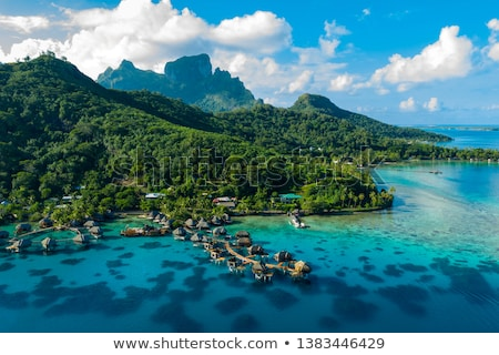 Bora Bora aerial drone image of travel vacation paradise and overwater bungalows Stock photo © Maridav