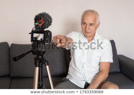 Senior blogger gelukkig elegante witte pak Stockfoto © pressmaster