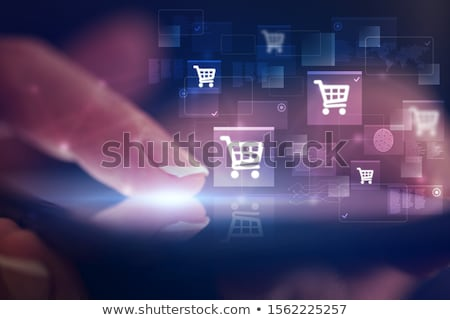 finger touching phone with online shopping concept stock photo © ra2studio