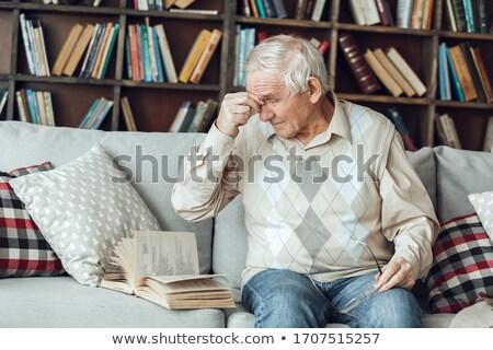 Starszy człowiek okulary nosa most Zdjęcia stock © dolgachov