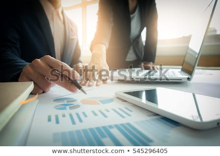 Business man's hands at working with financial plan and a laptop Stock photo © Freedomz