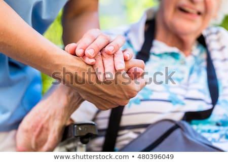 cuidador · mão · cadeira · de · rodas · mulher - foto stock © kzenon