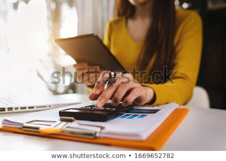 Professional business man working with smartphone, Doing finance Stock photo © Freedomz