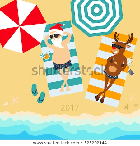 Christmas card with santa and reindeer at beach Stock photo © balasoiu