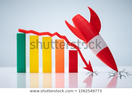 Rocket Landing Near Graph With Downward Arrow Stock photo © AndreyPopov