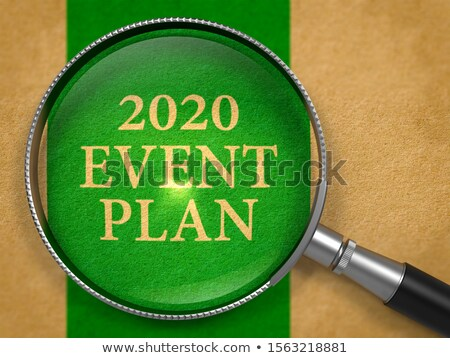 2020 Event Plan Through Loupe On Old Paper Foto stock © Tashatuvango