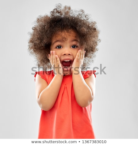 surprised or scared little african american girl Stock photo © dolgachov