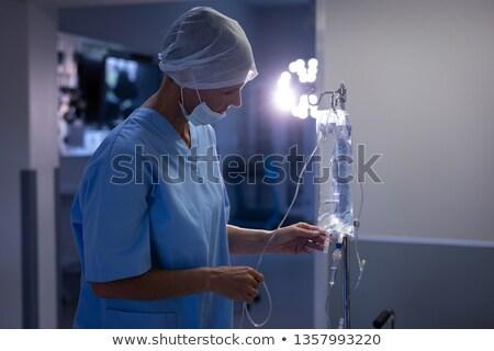 Oldalnézet kaukázusi női sebész intravénás terápia Stock fotó © wavebreak_media
