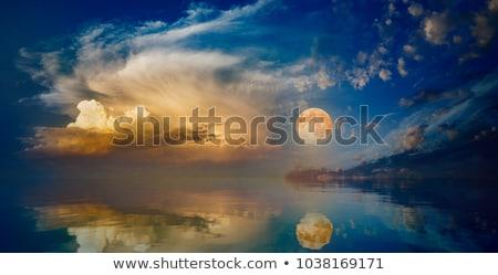 Lua cheia pôr do sol natureza deserto montanha azul Foto stock © olira