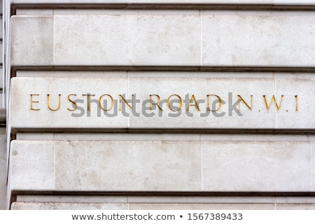 Letter E carved from stone Stock photo © ayaxmr