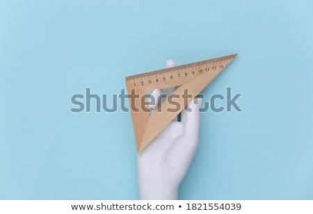 Mano triángulo gobernante suministrar neón Foto stock © yupiramos