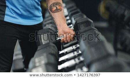 Tornaterem férfi fitnessz képzés karok emel Stock fotó © Maridav