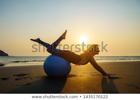 sport blond makes exercise with ball stock photo © paha_l