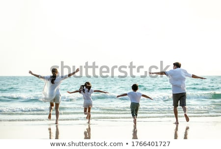 mother with children runs on sand stock photo © paha_l