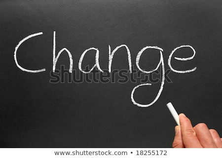 Writing the politically popular word Change with chalk on a blackboard. Stock photo © latent