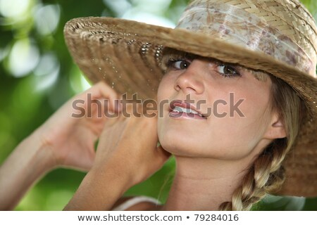 Closeup of striking young woman in a straw hat stock photo © photography33