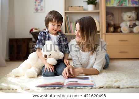 Young little girl lying with her book in living room stock photo © get4net