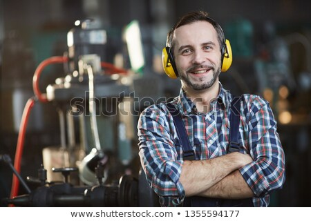 happy man wearing earmuffs cancelling noise Stock photo © photography33