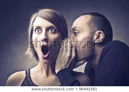 man telling secret to woman stock photo © photography33