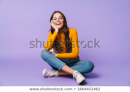 Joven sesión cruz pensando algo mujer Foto stock © stuartmiles