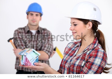 Female and male construction worker holding house made from money Stock photo © photography33