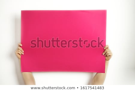 Happy woman holding blank billboard stock photo © stockyimages