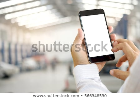 Man using a cellphone at a vehicle breakdown Stock photo © photography33