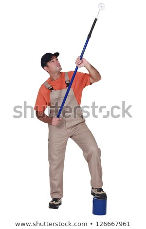 decorator using long roller to reach ceiling stock photo © photography33