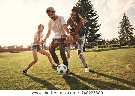 Stock fotó: Barátok · játszik · futball · égbolt · sport · természet