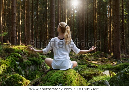 Beautiful armed girl in the forest Stock photo © acidgrey