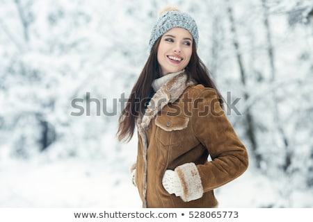 woman in sheepskin jacket stock photo © dolgachov