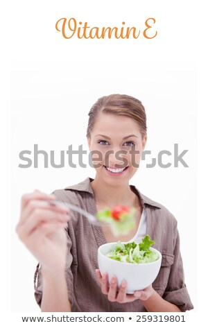 Young woman offering some salad against a white background Stock photo © wavebreak_media