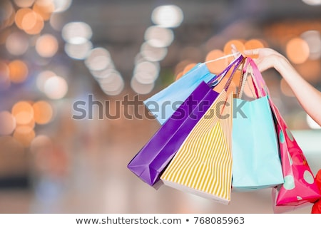 pretty young woman carrying a lot of gifts stock photo © pasiphae