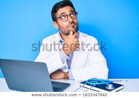 Lekarza myślenia strony podbródek biały muzyka Zdjęcia stock © wavebreak_media