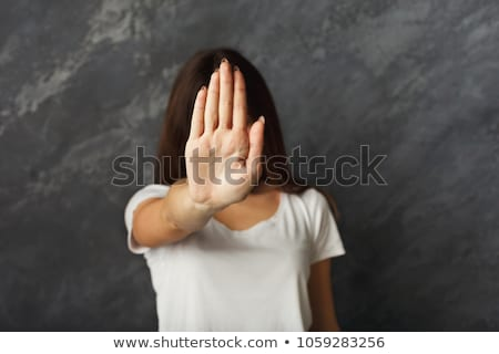 Portrait of a young girl making stop gesture  Stock photo © TarikVision