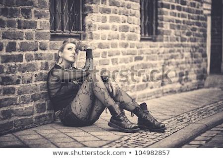 Young slim goth woman. On stone background. Stock photo © pxhidalgo