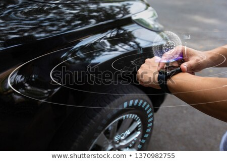 Man is controlling the tire pressure of his car Stock photo © Kzenon