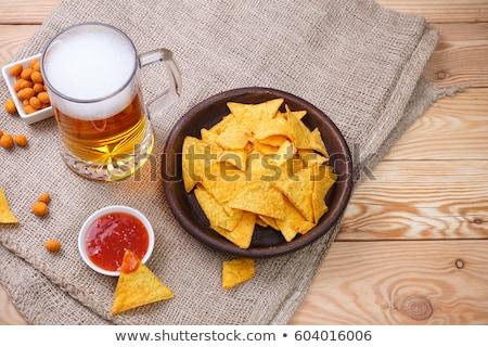 nachos · cerveja · servido · mesa · de · madeira · beber · garrafa - foto stock © phila54