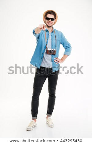 young man looks at you over sunglasses Stock photo © feedough