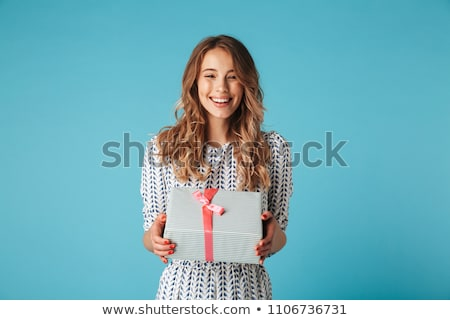 beautiful blond girl with a gift box stock photo © nejron