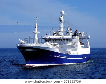 Fishing net on a winch of a fishing boat Stock photo © bmonteny