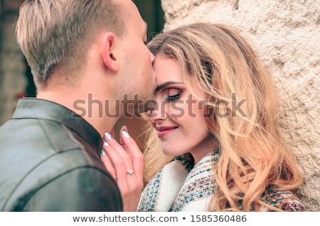 Loving young man kissing his girlfriend Stock photo © stryjek