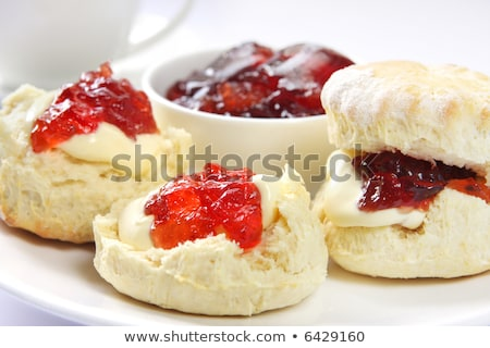 Fresh home baked scone with jam and clotted cream Stock photo © raphotos