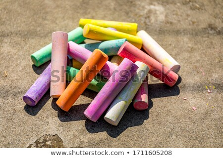 stick of color chalk on a blackboard isolated background stock photo © alexandrenunes