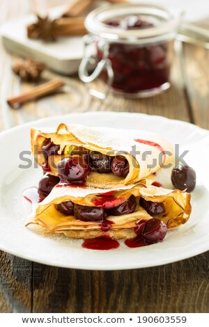 Pancakes with syrup and sour cherries Stock photo © aladin66