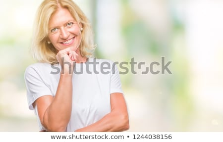 Happy Blond Woman with Hands on Chin Stock photo © dash