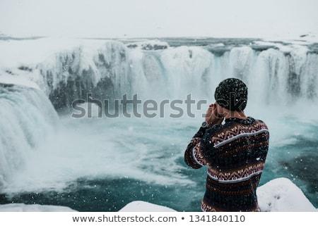 man in icelandic sweater by waterfall on iceland stock photo © maridav