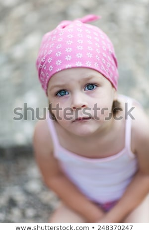 cute little pensive girl looking for someone or something stock photo © bubutu