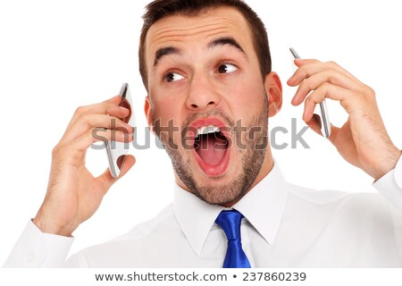 Businessman talking on two cell phones at the same time over white background Stock photo © deandrobot