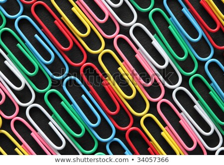 diagonal rows of colorful paper clips on black card stock photo © latent
